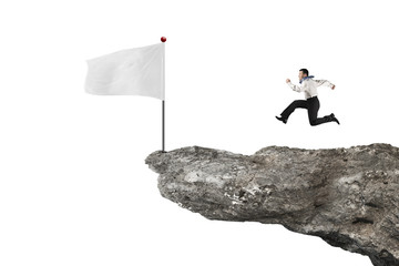 man running to blank flag on cliff with white