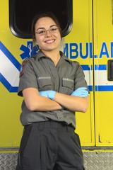 A paramedic, closing the door of the ambulance.