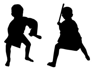 Silhouettes of two little boys who playing karate with stick
