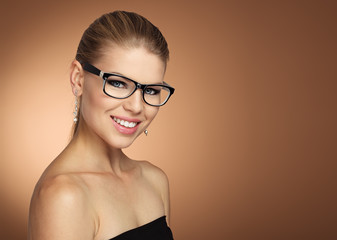 Young lovely model wearing optical eyeglasses. Eyesight concept