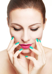 Beautiful woman with make up and colorful nails