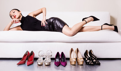 Beautiful woman with many shoes