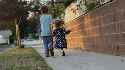 Touching clip of young siblings holding hands