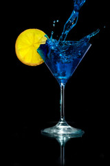 Pouring Blue Martini into the Martini Glass with Lemon