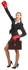 Businesswoman wearing boxing gloves wins