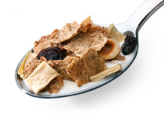 Muesli with fruits in yogurt spoon closeup isolated on white bac