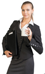 Businesswoman holding clipboard and mug