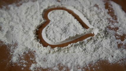 woman pours flour