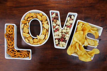 Love snacks Snacks in Love letter bowls on dark wood