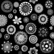 White doodle flowers over black background seamless pattern
