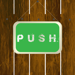 Push sign hanging on a wooden fence