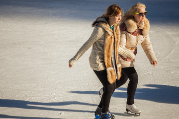 two girls of teenagers on the ice