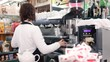 barista female making a coffee with professional machine - dolly