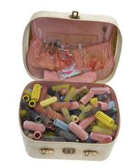Lockenwickler in einem Koffer