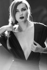 Blonde woman wearing black dress black and white