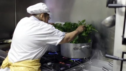 Italian chef cooking vegetables