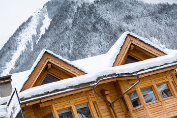 Snow covered chalet in the mountains