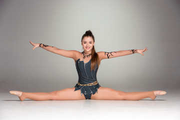 portrait of a gymnast stretching twine