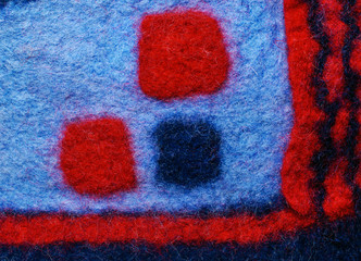 Multicolored square fabric texture of wool.