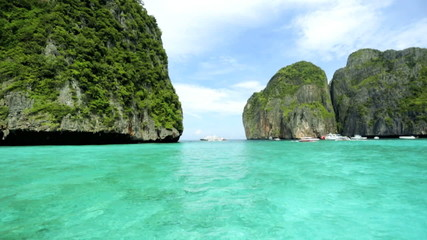 Limestone cliffs emerald green water, Phi Phi Island, Thailand