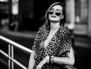 Woman wearing a leopard-skin dress black and white