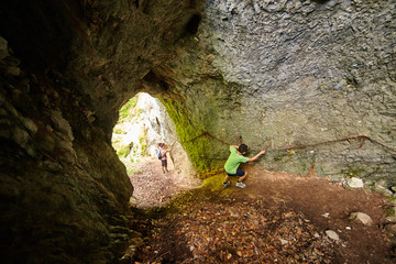 Family of hikers in a cave