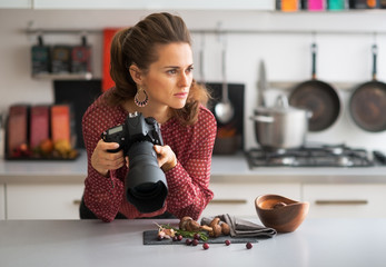 Portrait of thoughtful female food photographer