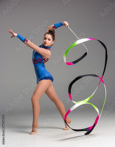 Foto op Canvas Dance School teenager doing gymnastics dance with ribbon