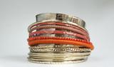Fototapety Orange bracelet set and shiny silver bracelet