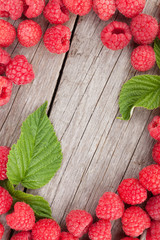 Fresh ripe raspberries on wooden table