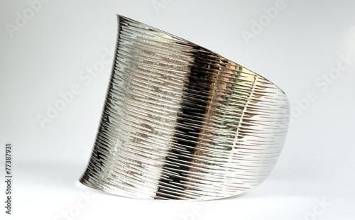 Leinwanddruck Bild shiny silver bracelet from the side view