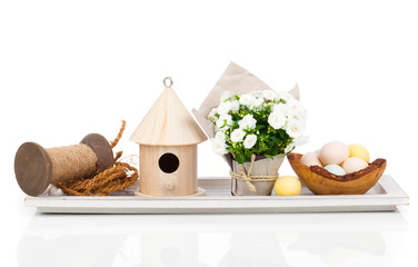 Easter eggs with birdhouse and white Campanula flowers , isolate