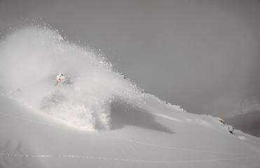 Austria, Salzburg, Gastein, Skier descending slope in cloud of powder snow