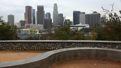 A View of Los Angeles skyline with stone dike in the foreground