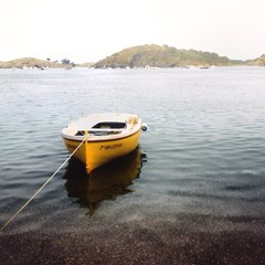 Spain, Cadaques, Boat anchored in calm water