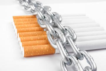 Chained cigarettes. Conceptual image.