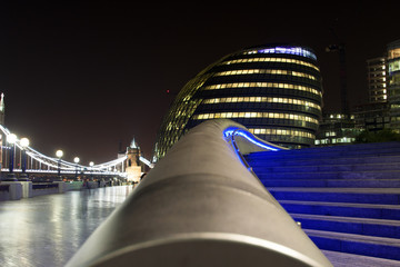 United Kingdom, London, View of facade of City Hall and Tower Bridge in background