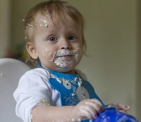 Baby boy messy after eating yoghurt