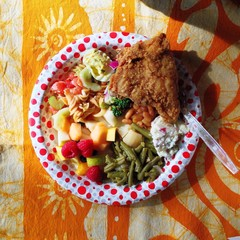 Plate of buffet food on tablecloth