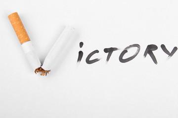 Broken cigarette Victory. Stop smoking concept