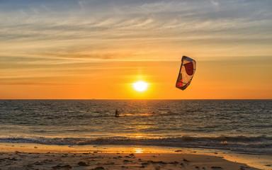 Silhouette of person kitesurfing