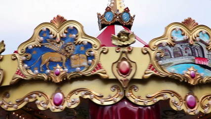 Close up of the top part of the carousel
