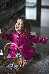 Little girl (4-5) screaming by basket of cosmetics