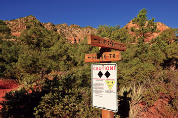 USA, Arizona, Sedona, Warning sign for hikers and bikers in forest