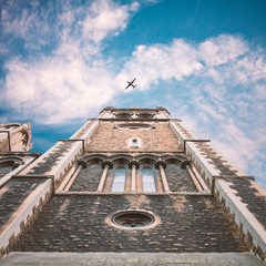 United Kingdom, England, London, St Matthew's Church, Upward view of church tower with plane flying in sky above