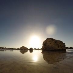 United Kingdom, England, East Sussex, Beachy Head, Rising sun reflecting in calm rock pool