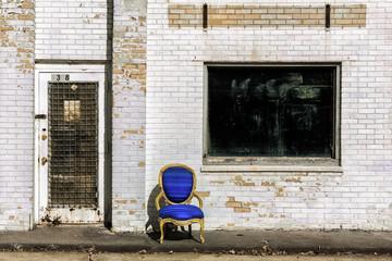 USA, Iowa, Cedar Rapids, Armchair in front of old building