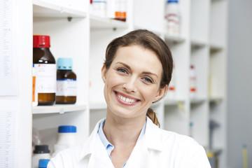 Laboratory technician smiling at camera