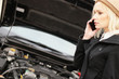 Young woman calling roadside assistance