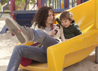 Spain, Mother and son relaxing in playground
